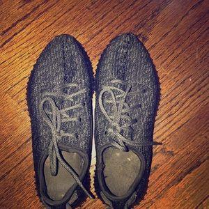 Black yeezy boost sneakers